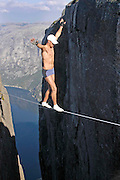 "This Daredevil's Balancing Feats Above 3,000ft Drops Are a Potentially Fatal Form of Art<br /> <br /> Poised perilously on a tightrope approximately 3,280 feet up in the air above the majestic Lysefjord in southwestern Norway, Eskil Ronningsbakken must fight hard to manage his fear. There is no safety net beneath his wire and no harness holding him in place. This is not an insured stunt to play back on the silver screen. Ronningsbakken knows that one slight misstep will result in certain death, yet he puts that out of his mind and continues to place one foot in front of the other. Then again, Eskil Ronningsbakken is no ordinary Joe: for many years now the Norwegian daredevil has been stupefying and scaring in equal measure with his gravity- – and, some would argue, sanity- – defying ""extreme art.""<br /> <br /> Indeed, Ronningsbakken's incredible acrobatic art has often found him balancing off the edges of cliffs and above deadly drops, on props ranging from tightropes and ladders to bicycles and chairs. And these outrageous acts have in fact enabled the highly skilled performer and conceptual artist to traverse the globe and take his stage in over 100 nations.<br /> <br /> It's perhaps reassuring to learn that Ronningsbakken is no novice with regard to this highly unusual – and exceptionally dangerous – craft. On the contrary, this individual has devoted much of his life to honing his ability to create audaciously high-up art. ""I have known from an early age how I wanted to spend my life and never doubted my professional decisions,""<br /> <br /> Indeed, the mid-30s action maestro from Stange in Norway claims to have known what kind of life he wished to pursue even as a spirited five-year-old. Through to his teens, he explored his native country's beautiful yet potentially hazardous backdrop, while the tranquil balancing of an Indian yogi on TV also motivated an impressionable young Ronningsbakken.<br /> <br /> Ronningsbakken became involved with a circus troupe at 18 years old, sharpened his skills un"