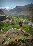View of Khorog from the Botanical Garden, the second highest one in the world. <br /> <br /> The town of Khorog (2200m), is the capital of the Gorno-Badakhshan Autonomous Province (GBAO) in Tajikistan. It is situated in the Pamir Mountains (ancient Mount Imeon) at the confluence of the Gunt and Panj rivers.<br /> The city is bounded to the south and to the north by the deltas of the Shakhdara and Gunt rivers, respectively. The two rivers merge in the eastern part of the city flow through the city, dividing it almost evenly until its delta in the river Panj, also being known as Amu Darya, or in antiquity the Oxus on the border with Afghanistan. Khorog is known for its beautiful poplar trees that dominate the flora of the city.<br /> Khorog is one of the poorest areas of Tajikistan, with the charitable organization Aga Khan Foundation providing almost the only source of cash income. Most of its inhabitants are Ismaili Muslims.<br /> <br /> Tajikistan, a mountainous landlocked country in Central Asia. Afghanistan borders it to the south, Uzbekistan to the west, Kyrgyzstan to the north, and People's Republic of China to the east. Tajikistan also lies adjacent to Pakistan separated by the narrow Wakhan Corridor.<br /> Tajikistan became a republic of the Soviet Union in the 20th century, known as the Tajik Soviet Socialist Republic.<br /> It was the first of the Central Asian republic to gain independence in December 1991.
