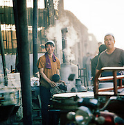Portrait of workers at a street cafe, Silk Route, Turpan, Xinjiang Province, China.