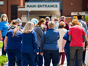 """06 MAY 2020 - DES MOINES, IOWA: Members of the nursing staff at Unity Point Health Iowa Methodist Medical Center in Des Moines, walk back to work after an """"appreciation loop"""" by Des Moines first responders. Des Moines first responders, the Iowa State Patrol, and utility companies made an """"Appreciation Loop"""" around the hospital on National Nurses' Day to thank nurses and other care givers at the hospital for the care they are providing during the COVID-19 (Coronavirus/SARS-CoV-2) pandemic. Iowa reported 10,404 confirmed cases of COVID-19 statewide Wednesday, about 2,500 cases in the Des Moines metropolitan area. Acting against the advice of many medical professionals, the Governor of Iowa has started reopening businesses in the state. Businesses in the Des Moines area, and other communities with a high number of cases are not allowed to reopen.       PHOTO BY JACK KURTZ"""