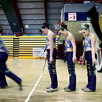 Nederland, Amsterdam , 16 januari 2010..De Nederlandse kampioenschappen Baton Twirling in de Sporthallen Zuid Amsterdam..Twirlen is een sport waarbij bewegingen worden gemaakt met een baton. De bewegingen zijn meestal dans en gymnastische bewegingen op allerlei verschillende soorten muziek..Je hebt super veel onderdelen met twirlen want je hebt; 1-baton, 2-baton, duotwirling, strutting, basic-strut en twirlteams in small en large. Deze onderdelen doe je op verplichte N.B.T.A.-muziek. Ook heb je dan nog dance-twirl, smallteam dance, largeteam dance en pomponteams..Op de foto het team The Rainbows bij aanvang van hun act...Foto:Jean-Pierre Jans