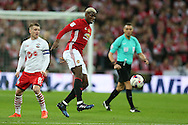 Paul Pogba of Manchester Utd (c) gets to the ball ahead of Steven Davis of Southampton (l). EFL Cup Final 2017, Manchester Utd v Southampton at Wembley Stadium in London on Sunday 26th February 2017. pic by Andrew Orchard, Andrew Orchard sports photography.