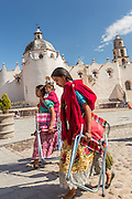 Indigenous pilgrims holds a procession past the Sanctuary of Atotonilco an important Catholic shrine in Atotonilco, Mexico.