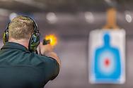 Kevin Sebastian of Frogbones Family Shooting Center shoots at the range.