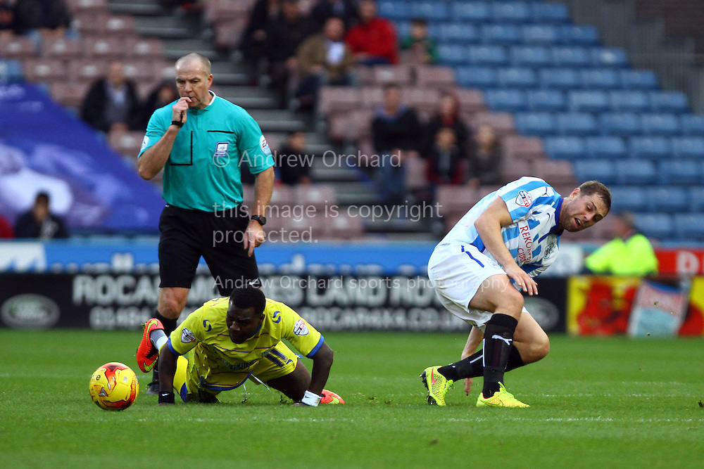 Referee Graham Salisbury blows for a foul on Royston Drenthe of Sheffield Wednesday by Grant Holt of Huddersfieldl Town. Skybet football league championship match, Huddersfield Town v Sheffield Wednesday at the John Smith's stadium in Huddersfield, Yorkshire on Saturday 22nd November 2014.<br /> pic by Chris Stading, Andrew Orchard sports photography.