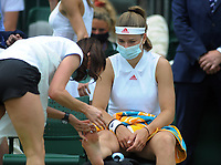 Tennis - 2021 All England Championship - Week One - Day Four (Thursday) - Wimbledon<br /> Karolina Muchova v Camila Giorgi<br /> <br /> Karolina Muchova gets some attention to her big toe<br /> <br /> CreditCOLORSPORT/Andrew Cowie