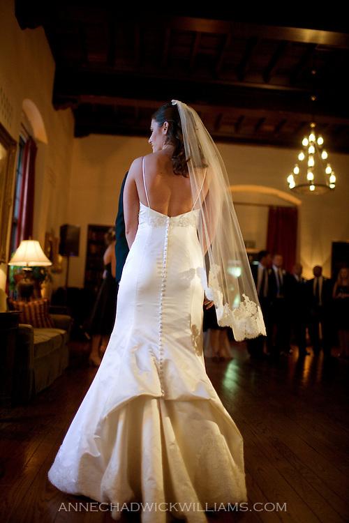 A bride at her wedding reception in the Sutter Club, Sacramento, California.