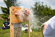 20140601 Free for editorial use image<br /> <br /> Halifax colleagues in Bournemouth are proud to give extra back to their local community by hosting their Big Lunch event on Sunday 01 June 2014.<br /> <br /> Halifax Local Director Dave Jeffery gets a soaking in the stocks during The Big Lunch at the New Leaf Allotment in Bournemouth. <br /> <br /> For more information please contact: Catherine Eastham on 020 3697 4304<br /> <br /> If you require a higher resolution image or you have any other onEdition photographic enquiries, please contact onEdition on 0845 900 2 900 or email info@onEdition.com<br /> This image is copyright the onEdition 2014©.<br /> This image has been supplied by onEdition and must be credited onEdition. The author is asserting his full Moral rights in relation to the publication of this image. Rights for onward transmission of any image or file is not granted or implied. Changing or deleting Copyright information is illegal as specified in the Copyright, Design and Patents Act 1988. If you are in any way unsure of your right to publish this image please contact onEdition on 0845 900 2 900 or email info@onEdition.com