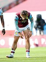 Football - 2019 / 2020 Premier League - Aston Villa vs. Chelsea<br /> <br /> Jack Grealish of Aston Villa looks at studs marks on his leg at Villa Park. <br /> <br /> <br /> COLORSPORT/LYNNE CAMERON