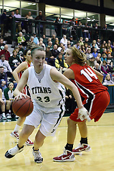 29 January 2011: Olivia Lett storms past Diana Jacklin during an NCAA Womens basketball game between the Carthage Reds and the Illinois Wesleyan Titans at Shirk Center in Bloomington Illinois.