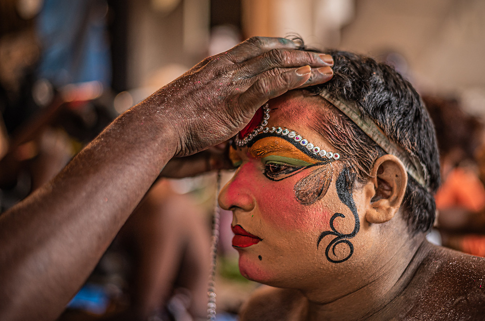 A man applying making up and getting ready for the Bonalu festival procession at Hyderabad, India on 07/28/2019. People put on costumes and walk on the<br /> streets to entertain the people on the sidewalks for the Bonalu festival. Photo by Akash Pamarthy.
