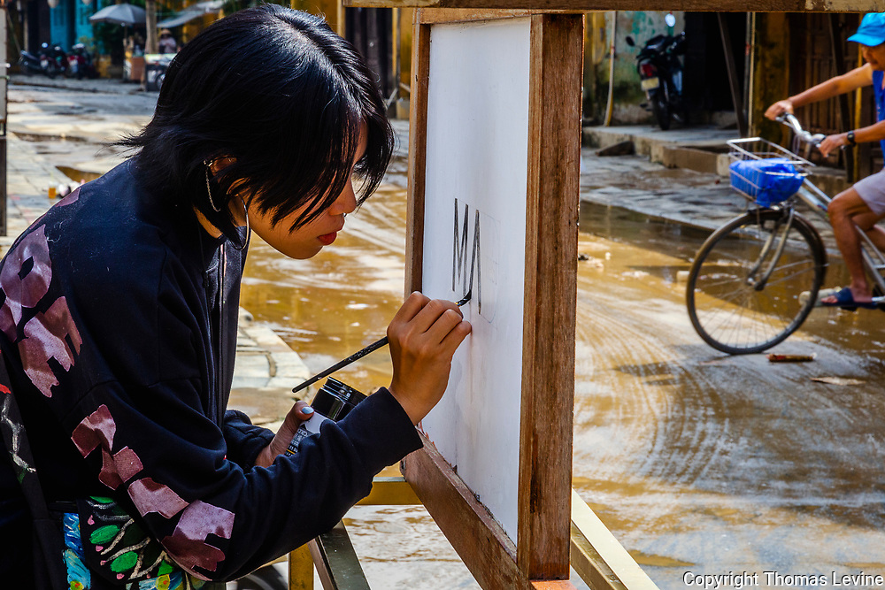 Hoi An Artist on the streets of Ancient Town.
