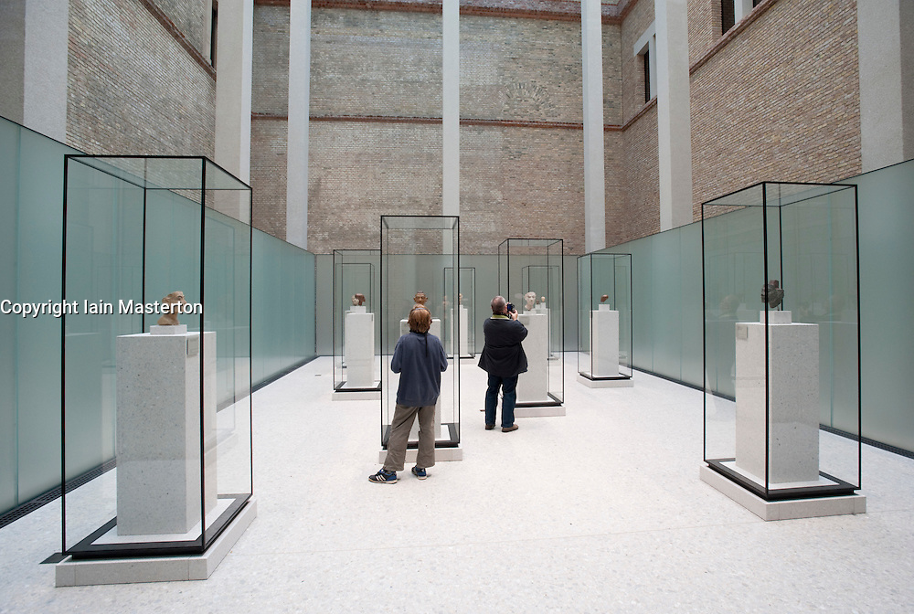 Egyptian busts on platform within Egyptian courtyard at Neues Museum or New Museum on Museumsinsel or Museum Island in Berlin