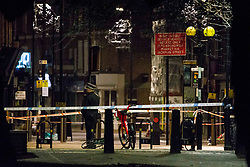 © Licensed to London News Pictures.22/11/2020. London, UK. Police guard a crime scene following a shooting near London Fields in east London. A woman in her 30s is fighting for her life after she was shot in Hackney. Met Police say at 8:52pm they were called to Westgate Street. No arrests have been made. Photo credit: Marcin Nowak/LNP