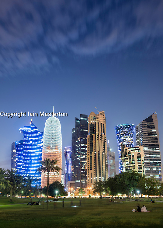 Night view of modern office towers in West Bay financial and business district in Doha Qatar