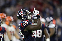 Houston Texans' Whitney Mercilus (59) celebrates after sacking Cincinnati Bengals quarterback Andy Dalton during the second half of an NFL football game Saturday, Dec. 24, 2016, in Houston. (AP Photo/Sam Craft)
