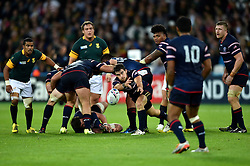 Niku Kruger of the USA passes the ball - Mandatory byline: Patrick Khachfe/JMP - 07966 386802 - 07/10/2015 - RUGBY UNION - The Stadium, Queen Elizabeth Olympic Park - London, England - South Africa v USA - Rugby World Cup 2015 Pool B.
