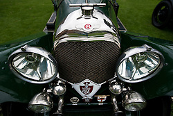 © Licensed to London News Pictures. 13/07/2015. Epsom, UK. Detail of the front of a classic Bentley. The start of The Royal Automobile Club 1000 Mile Trial 2015 at Woodcote Park in Epsom, Surrey. The event, which starts and finishes at Woodcote Park, takes a fleet of over 40 classic cars from around the world, through a 1000 mile trial around the UK.  Photo credit: Ben Cawthra/LNP