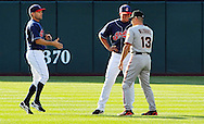 Omar Vizquel meets with his replacement in Cleveland, Jhonny Peralta, before his first game back in Cleveland.  Also pictured is Jamey Carroll.