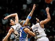 SHOT 5/4/2005 - The Denver Nuggets' Kenyon Martin (#6) battles  the San Antonio Spurs' Manu Ginobili (#20) and Robert Horry (#5) for a rebound during the third quarter of Game 5 of their first round NBA Playoff series at the SBC Center Wednesday May 4, 2005. The Nuggets lost the game 99-89 and were eliminated from the NBA Playoffs with the loss..