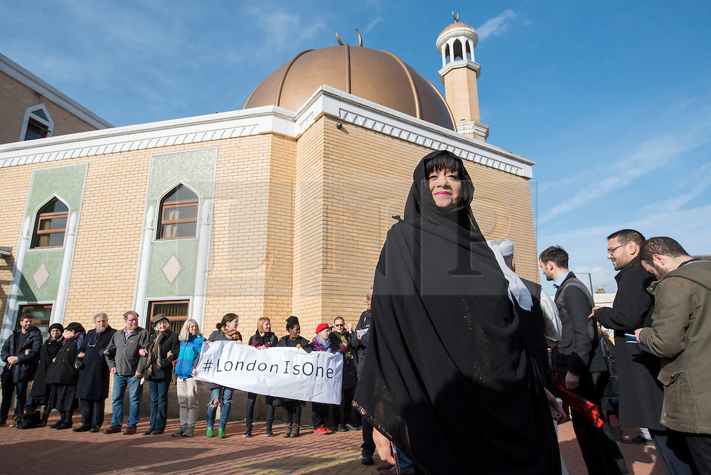 """© Licensed to London News Pictures. 03/02/2017. London, UK.  Bibi Rabbiyah Khan, from the London Islamic Cultural Society, stands in front of a human circle of solidarity forming outside Wightman Road mosque in north London during Friday prayers in an event backed by a coalition of faith groups, including members of Reform Judaism, the Christian Muslim Forum and Faiths Forum for London.  The aim is to """"stand with our Muslim brothers and sisters at this time of international turbulence"""", say the organisers. Photo credit : Stephen Chung/LNP"""