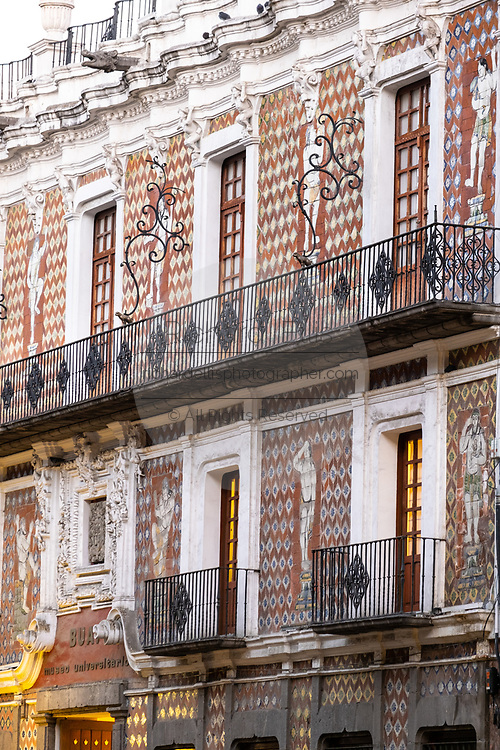 The Biblioteca Palafoxiana exterior facade, covered with colonial Talavera pottery in the historic center of Puebla, Mexico. Founded in 1646, it is recognized by UNESCO as the first and oldest public library in the Americas.
