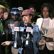 The sister of deceased Orlando Police officer Master Sgt. Debra Clayton speaks about her sister at a vigil at an Orlando Walmart on January 10, 2017 in Orlando, Florida. Orange County deputy Norm Lewis who was also killed on his motor patrol while responding to Clayton's shooting was also honored.  (Alex Menendez via AP)