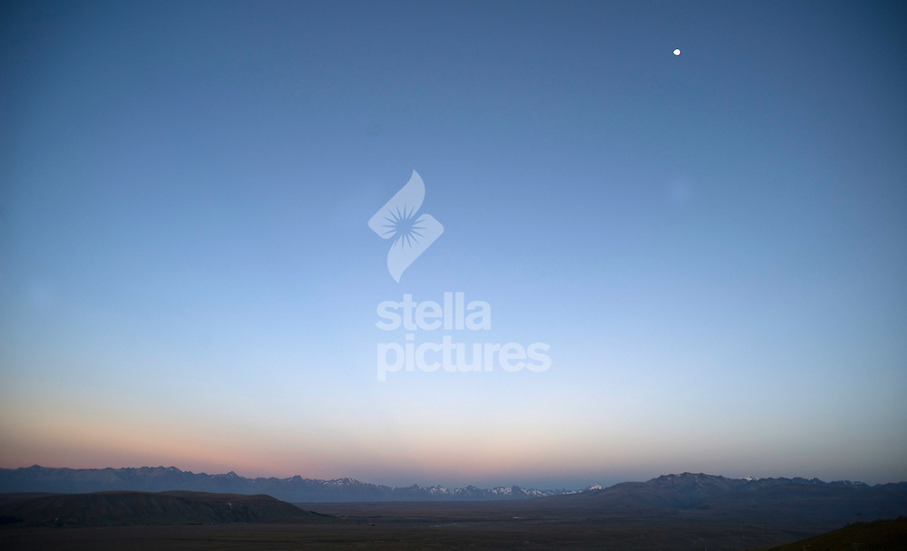 Picture by Daniel Hambury. .24/1/11..A view at sunrise of the Southern Alps from Mount John in the Mackenzie Basin near Lake Tekapo, New Zealand.