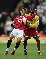 Photo: Lee Earle.<br /> Watford v Manchester United. The Barclays Premiership. 26/08/2006. United's Cristiano Ronaldo (L) battles with Chris Powell.