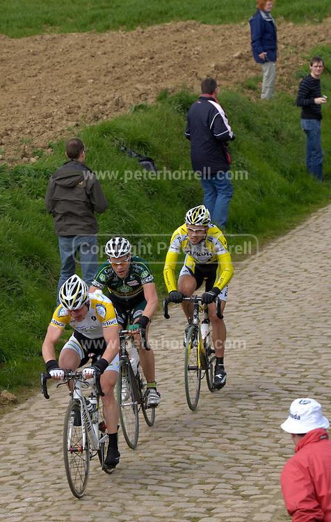 Quievy - Sunday, Apr 13 2008:  Matthé PRONK, CYCLE COLLSTROP,   Jan KUYCKX, LANDBOUWKREDIET - TÖNISSTEINER and Alexander SEROV, TINKOFF CREDIT SYSTEMS, lead the race over the pavé at Quievy (km 107 - 3700 m). Images from the 106th edition of the Paris Roubaix (1.HC) cycle race. Starting in Compiègne, north of Paris, the race finishes 259.5 km later in Roubaix. This year's edition included 52.8 km on the famous pavé. (Photo by Peter Horrell / http://www.peterhorrell.com)