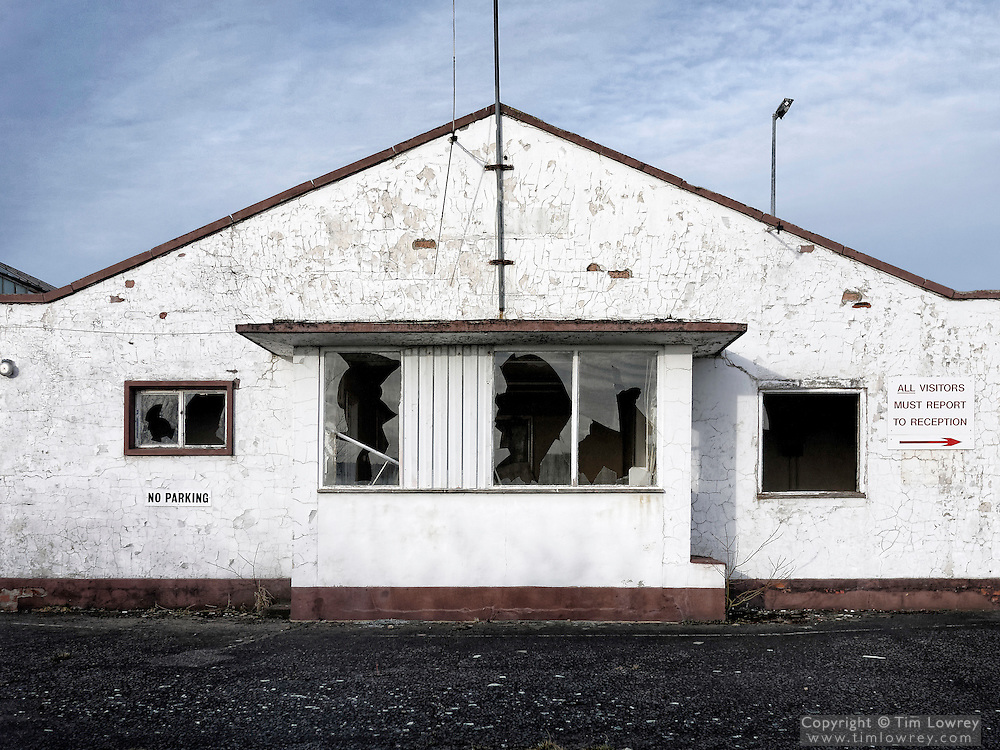 The Abandoned White Painted Main Entrance To The Former Marley Tiles Factory Near Newlands, Northumberland.
