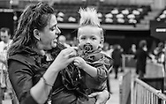Mary Jeffrey, of Bluff Creek, LA holding her 19 month old son Curtis Ray Jeffrey II, a professional baby model whose hair is worn to mimic Trumps at a campaign rally in Baton Rouge, LA for Republican presidential candidate Donald Trump, before he arrives.