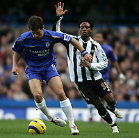 Photo: Lee Earle.<br /> Chelsea v Newcastle United. The Barclays Premiership.<br /> 19/11/2005. Chelsea's Joe Cole (L) holds of Celestine Babayaro.