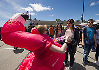 Keeping with the festive atmosphere Madalyn hands out leis from Auntie Nae's Dole Whip Treats Food Truck to Khloe Hamell and Shevy Young during Tanger Outlet's Exit 20 Food Truck Festival on Saturday.  (Karen Bobotas/for the Laconia Daily Sun)