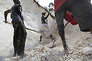 Men work collecting rock that will be made into plaster in the mountain above Carrefour, Haiti.  With over 2/3 of the country unemployed, jobs are far and few between, giving people no choices in what they have to do.