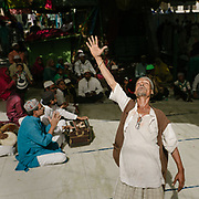 A Sufi man proclaiming his love to God in the Ajmer Sharif Dargah mosque in Ajmer.