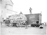 Box car #4259 on siding with wagon load of sacks.<br /> D&RG    ca 1898<br /> Same as RD054-053.