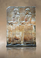 Stone relief sculptured panel of two functionaries. Room 811. Inv AO 19876 from Dur Sharrukin the palace of Assyrian king Sargon II at Khorsabad, 713-706 BC.  Louvre Museum Room 4 , Paris .<br /> <br /> If you prefer to buy from our ALAMY PHOTO LIBRARY  Collection visit : https://www.alamy.com/portfolio/paul-williams-funkystock/ancient-assyria-antiquities.html  Refine search by adding background colour, place, subject, museum etc into the LOWER SEARCH WITHIN GALLERY box to <br /> <br /> Visit our ANCIENT WORLD PHOTO COLLECTIONS for more photos to download or buy as wall art prints https://funkystock.photoshelter.com/gallery-collection/Ancient-World-Art-Antiquities-Historic-Sites-Pictures-Images-of/C00006u26yqSkDOM