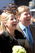 Her Majesty the queen and members of the royal family celebrate Saturday 29 April 2006 Queensday in the province flevoland in the cities  Zeewolde and almere.<br /> <br /> Hare Majesteit de Koningin en leden van de Koninklijke Familie vieren zaterdag 29 april 2006 Koninginnedag mee in de provincie Flevoland en wel in Zeewolde en Almere.<br /> <br /> On the Photo / Op dce foto: Willem Alexander and Princes Maxima lookingf at virtual biting-the-cake. / Willem Alexander en Princes Maxima kijken naar het virtueel koekhappen.