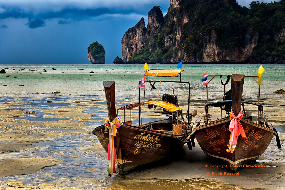 Low Tide, Ko Phi Phi: Two wooden power boats are stranded at low tide on a beautiful sandy shore line of Ko Phi Phi, Thailand.