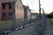 Detail of a barbed wire fence surrounding the Auschwitz Nazi concentration camp. It is estimated that between 1.1 and 1.5 million Jews, Poles, Roma and others were killed in Auschwitz during the Holocaust in between 1940-1945.