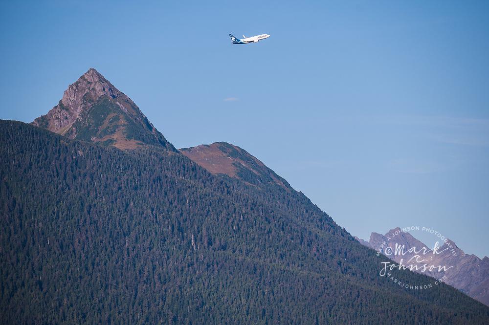 Alaska Airlines airplane taking off over Mt Verstovia, Sitka, Alaska, USA