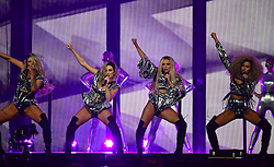 Little Mix's Perrie Edwards, Jesy Nelson, Leigh-Anne Pinnock and Jade Thirlwall performing on stage at the Brit Awards at the O2 Arena, London.