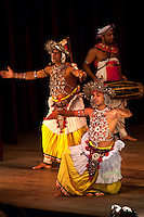 Kandyan Dance is a dance form that originated in the area called Kandy of the Central hills region in Sri Lanka. According to legend the origins of the dance lie in an exorcism ritual known as the Kohomba Kankariya which was originally performed by Indian shamans who came to the island. The dancers wear an elaborate costume including a headdress. The dancer's chest is covered by a decorative beaded net.