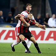 HARRISON, NEW JERSEY- OCTOBER 15: Hector Villalba #15 of Atlanta United is held by Damien Perrinelle #55 of New York Red Bulls during the New York Red Bulls Vs Atlanta United FC, MLS regular season match at Red Bull Arena, Harrison, New Jersey on October 15, 2017 in Harrison, New Jersey. (Photo by Tim Clayton/Corbis via Getty Images)