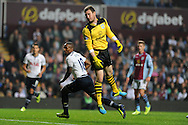 Tottenham's Jermain Defoe celebrates after he scores the 1st goal past Villa keeper Jed Steer.  Capital one cup 3rd round match, Aston Villa v Tottenham Hotspur at Villa Park in Birmingham on Tuesday 24th Sept 2013. pic by Andrew Orchard, Andrew Orchard sports photography.