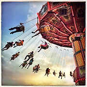 Swing ride at the fair at sunset