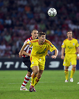 Photo: Chris Ratcliffe.<br /> PSV Eindhoven v Liverpool. UEFA Champions League, Group C. 12/09/2006.<br /> Steven Gerrard of Liverpool clashes with Timmy Simons of PSV.