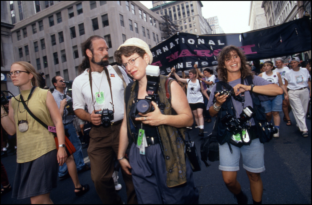 Donna Binder and Meryl Levin, both photographers with Impact Visuals, covering  the Lesbian Avengers at the annual Dyke March in June of 1994 in New York City.