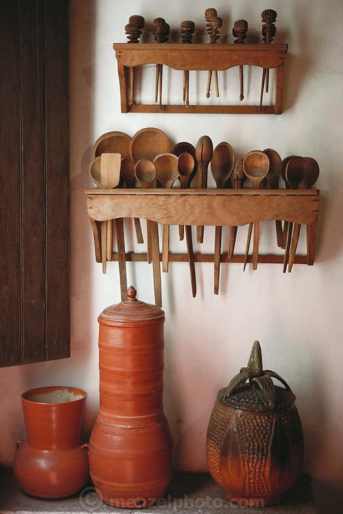 Ceramic museum display with wooden spoons in Guadalajara, Mexico.